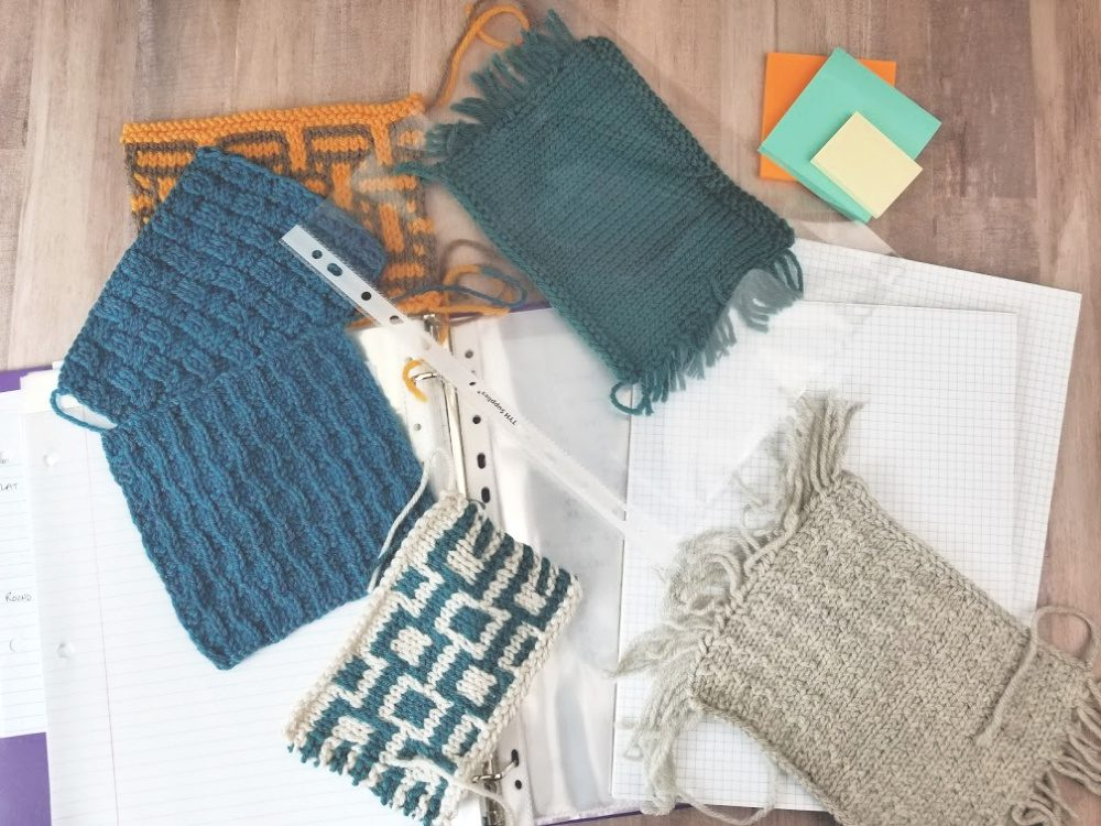 knitting journal supplies including grid paper, loose leaf paper, binder, and knitted swatches